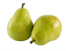 a close up on two fresh pears isolated on a white background